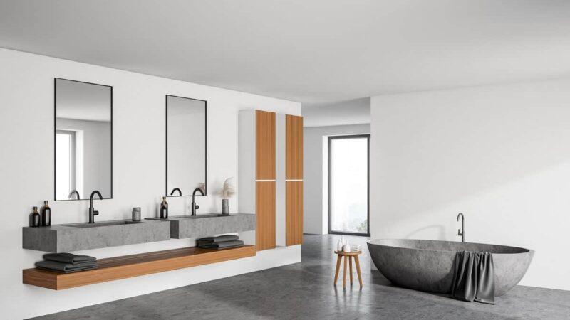 Ein Ablagefach unterhalb von einem Waschtisch aus Beton ist nicht nur praktisch, sondern sieht auch super aus
